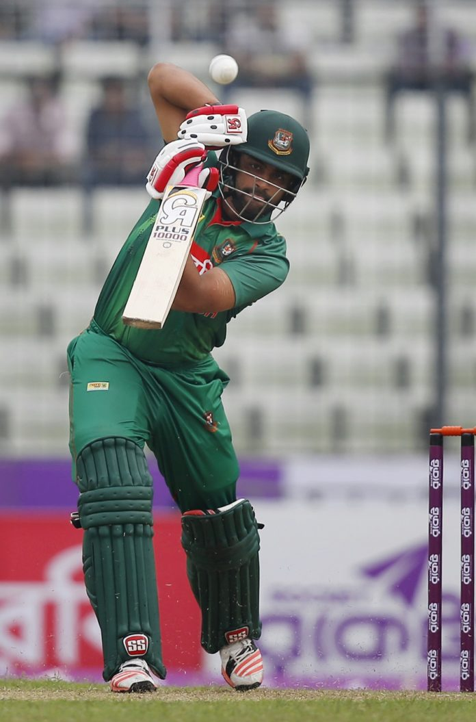 Bangladesh's Tamim Iqbal plays a shot during the second one-day international cricket match against Afghanistan in Dhaka, Bangladesh, Wednesday, Sept. 28, 2016. (AP Photo/A.M. Ahad)