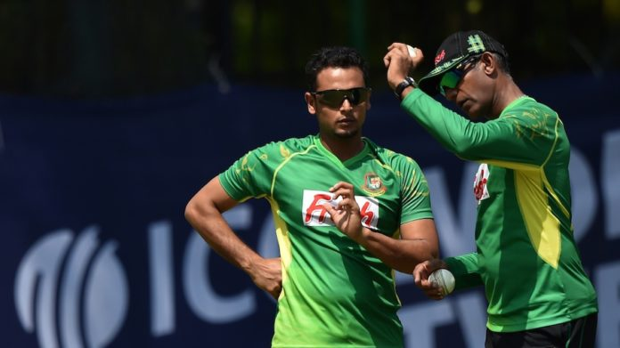 Bangladeshi spinner Arafat Sunny (L) who has been banned from bowling by the ICC for a a suspected illegal bowling action, listens to spin bowling coach Ruwan Kalpage during the team's practice session at The Chinnaswamy Stadium in Bangalore on March 20, 2016, on the eve of their World T20 cricket tournament match against Australia. / AFP / Kiran MANJUNATH        (Photo credit should read KIRAN MANJUNATH/AFP/Getty Images)